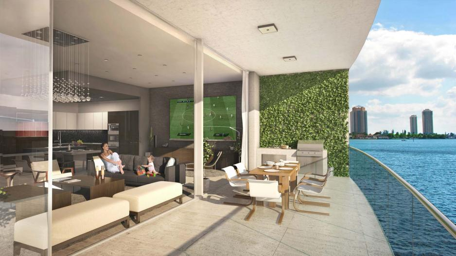 Living room with floor to ceiling doors opening out to large terrace
