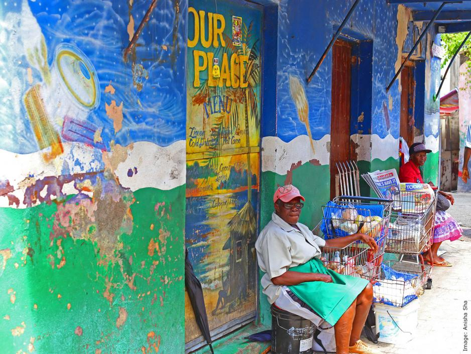 Woman sitting outside a spice market in Grenada