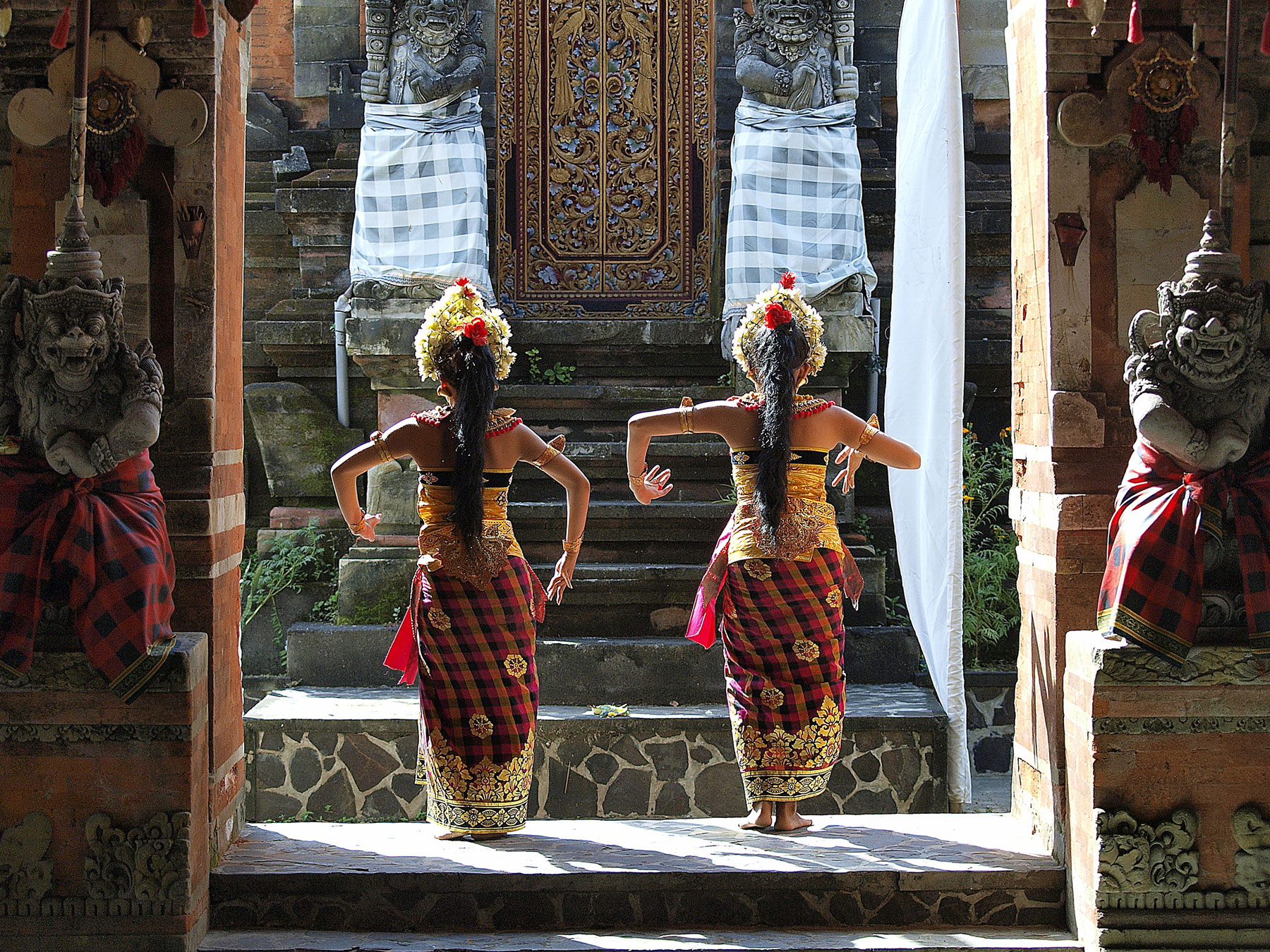 Two temple dancers in Indonesian temple