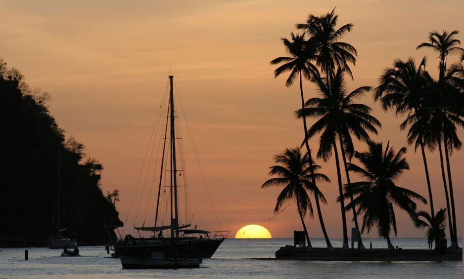 Sailing boat in harbour at sunset St Lucia