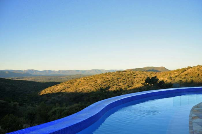 Pool and panoramic view from private game farm in South Africa