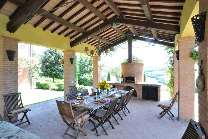 Outdoor dining area at luxury country estate Tuscany Italy