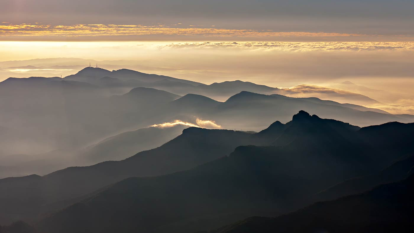Aerial of foggy mountains in Catalonia