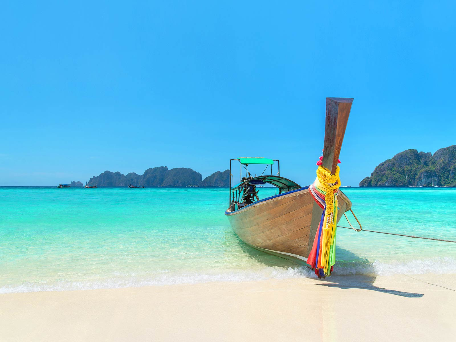 Traditional boat on beach in Phuket Thailand