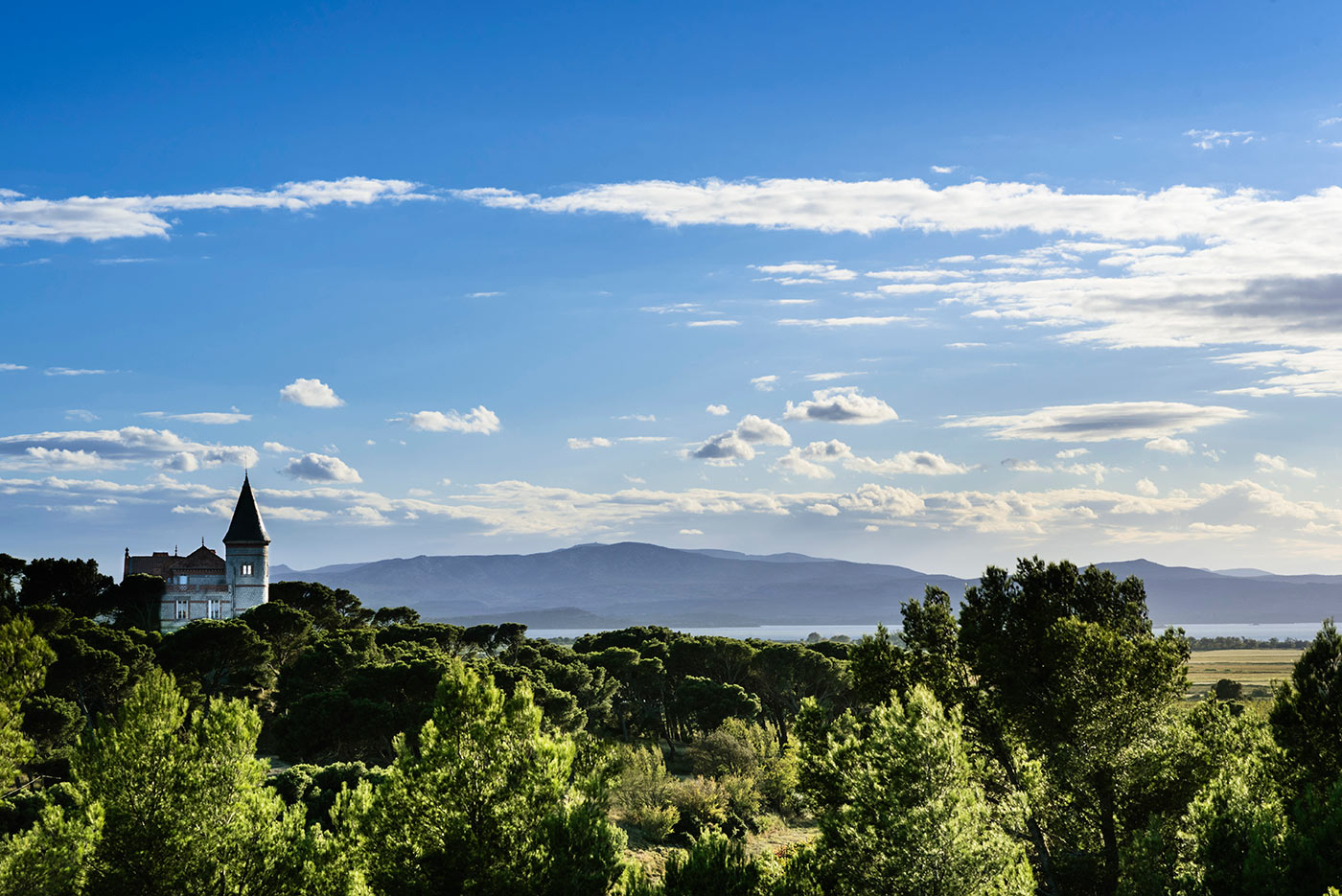 The tower of Chateau Capitoul and views of Etang de Bages in Languedoc