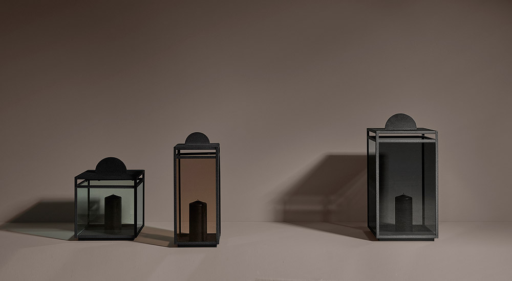 Three lanterns with coloured glass for indoor and outdoor use