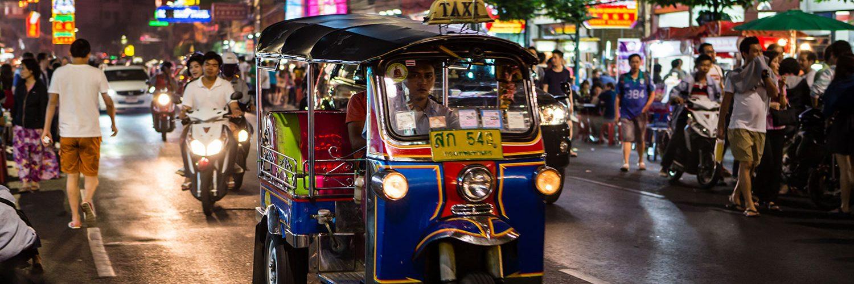 Tuk-tuk on busy street in Bangkok