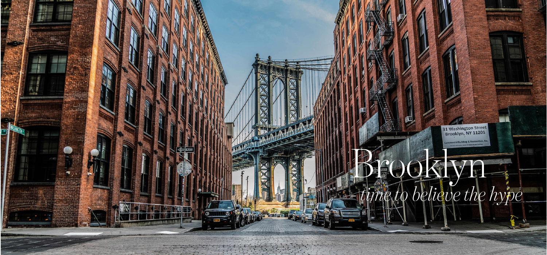 Brooklyn street with Manhattan Bridge in the background