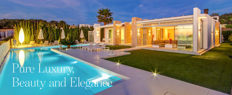 Luxury villa in Cala Conta Ibiza at night featured in The Address Magazine