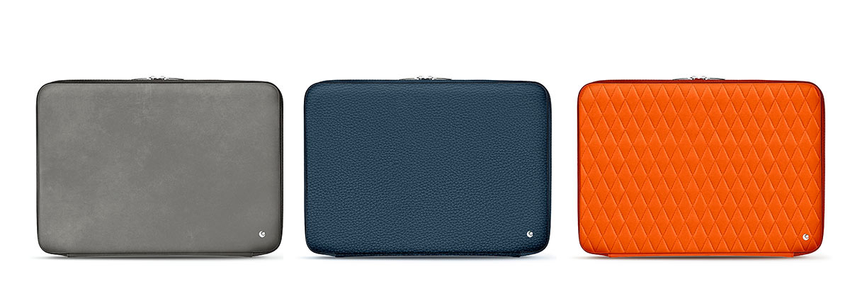 Noreve leather laptop cases in grey, blue and orange